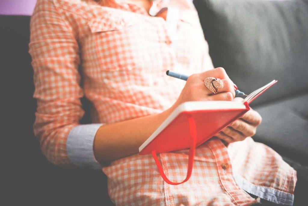 girl-writing-in-her-moleskine-diary-picjumbo-com